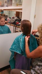 Katie's ponytail of hair being cut
