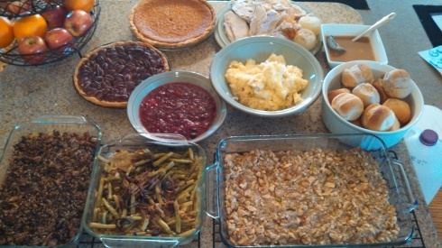 Thanksgiving dinner spread with green bean casserole