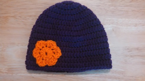 Purple Hat with Orange Flower